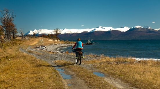 We left Tolhuin in the sunshine. Thanks to a map on the wall of the bakery, we found this gorgeous unpaved detour along Lago Fagnano. The flat, barren expanses of northern Tierra del Fuego were all but forgotten as ride back into mountains.