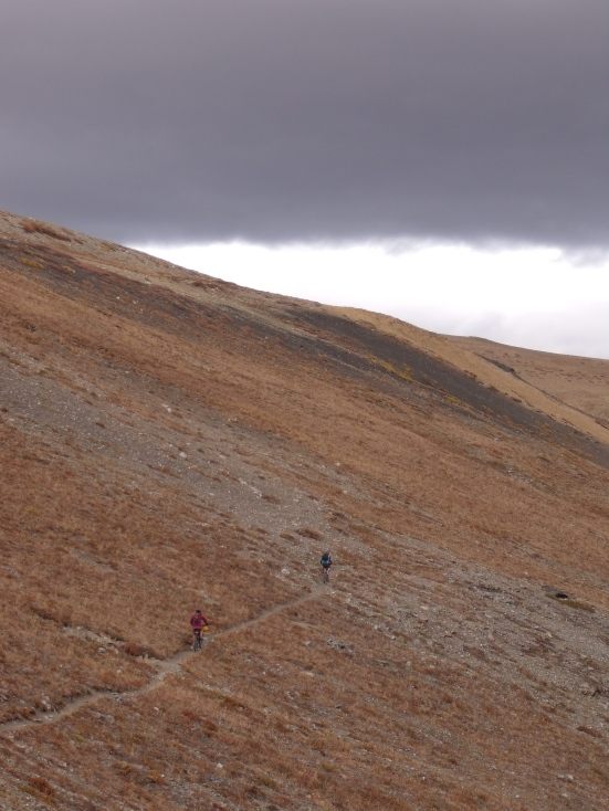 Coming down from the Pass, flying past marmot burrows and scree