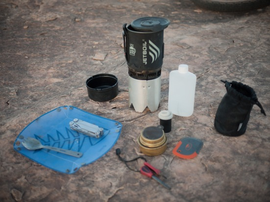 My alcohol stove cooking set-up. The nesting pot stand was meticulously home-made from a piece of aluminum flashing.