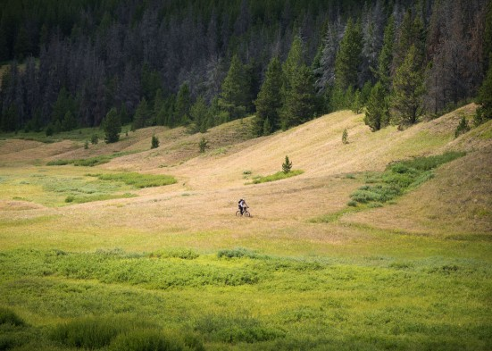 The meadowed valley bottoms of this part of the world make for fun, fast riding.