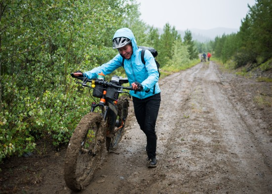 Not long after we get riding, the next morning, we are stopped dead by glopping mud...