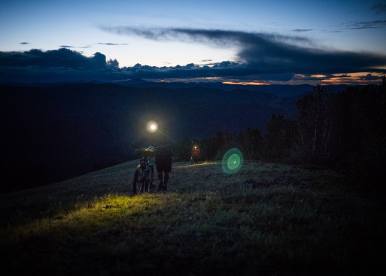Soon we're pushing in the dark, to a saddle 500m below the summit.